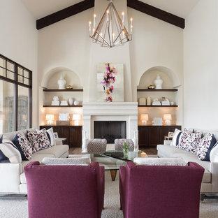 オースティンの広いトランジショナルスタイルのおしゃれなLDK (フォーマル、カーペット敷き、標準型暖炉、グレーの床、ベージュの壁、コンクリートの暖炉まわり、テレビなし) の写真