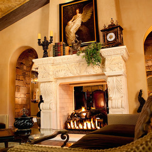 Photo of an expansive traditional formal enclosed living room in Phoenix with beige walls, dark hardwood floors, a two-sided fireplace and a stone fireplace surround.