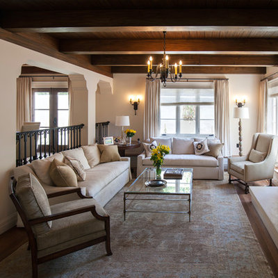 Mid-sized tuscan open concept dark wood floor living room photo in Santa Barbara with white walls, a standard fireplace and a stone fireplace