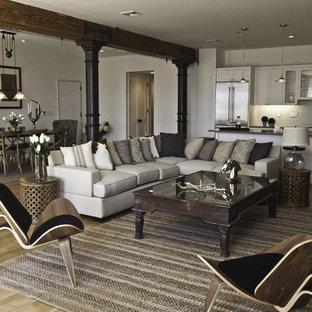 Idee per un grande soggiorno industriale stile loft con pareti bianche