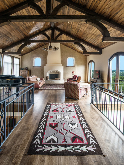 Inspiration For A Southwestern Loft Style Dark Wood Floor Living Room  Remodel In Austin With