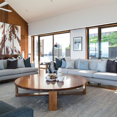 Example of a large trendy formal and open concept brown floor and dark wood floor living room design in Melbourne with white walls