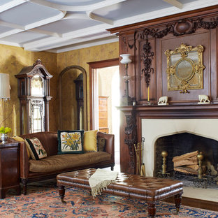 Inspiration for a classic formal living room in New York with a standard fireplace and yellow walls.