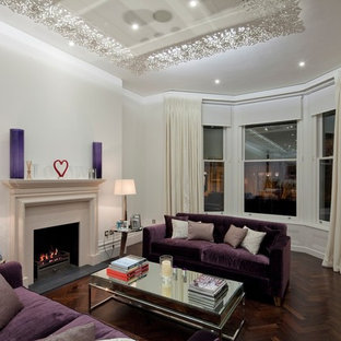 Living room - contemporary living room idea in London with white walls