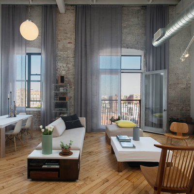 Urban medium tone wood floor living room photo in Philadelphia with white walls, no fireplace and no tv
