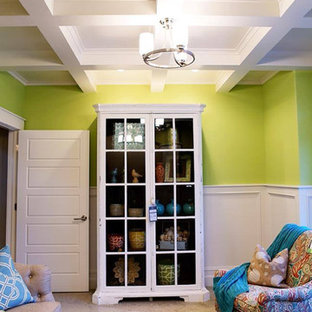 Design ideas for a mid-sized traditional living room in Salt Lake City with green walls and a library.