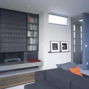 Inspiration pour un salon minimaliste avec un manteau de cheminée en carrelage.