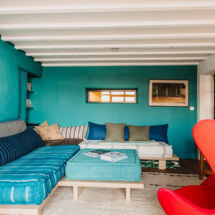 Inspiration for a medium sized beach style enclosed living room in Cornwall with blue walls, dark hardwood flooring, brown floors and exposed beams.