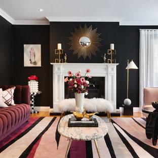 Immagine di un soggiorno chic chiuso con sala formale, pareti nere, pavimento in legno massello medio, camino classico, cornice del camino in legno, nessuna TV e pavimento arancione