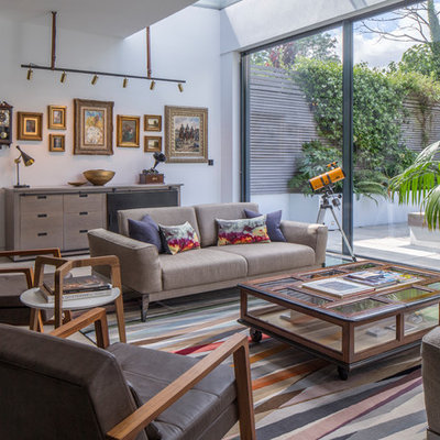 Living room - mid-sized contemporary open concept gray floor living room idea in London with white walls