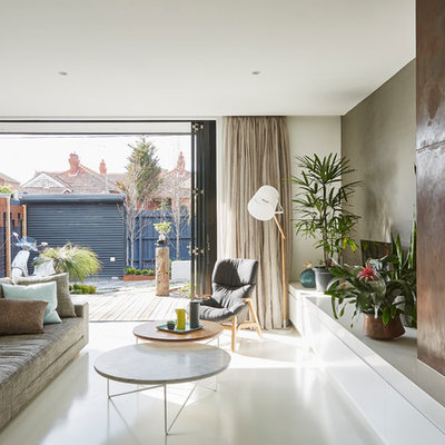 Inspiration for a mid-sized contemporary open concept concrete floor living room remodel in Melbourne with a standard fireplace, a metal fireplace and gray walls