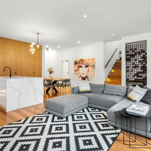 Inspiration for a large contemporary open concept living room in Melbourne with white walls and medium hardwood floors.