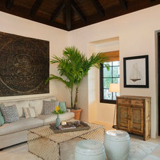 Tropical Living Room by Herlong & Associates Architects + Interiors
