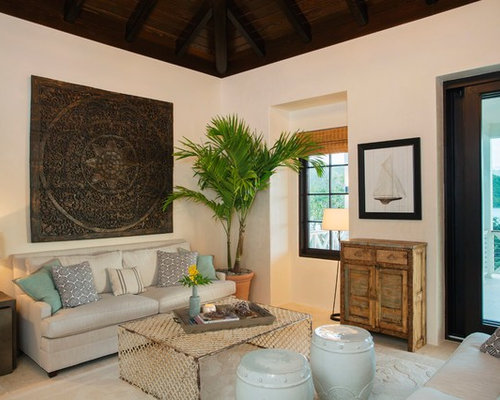 Inspiration For A Tropical Living Room Remodel In Charleston With White Walls