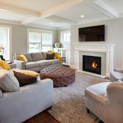 Living room - mid-sized transitional enclosed medium tone wood floor living room idea in Minneapolis with gray walls, a standard fireplace, a tile fireplace and a wall-mounted tv