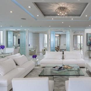Immagine di un grande soggiorno design aperto con sala formale, pareti bianche, pavimento in marmo, nessuna TV, camino lineare Ribbon, cornice del camino in pietra e pavimento bianco