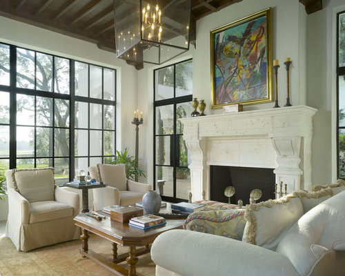 Tuscan Living Room Photo In Atlanta With White Walls And A Standard Fireplace