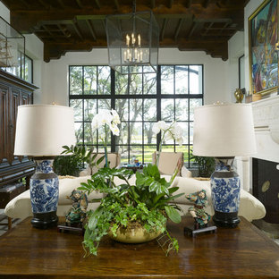 Inspiration for a mediterranean living room remodel in Atlanta with a standard fireplace