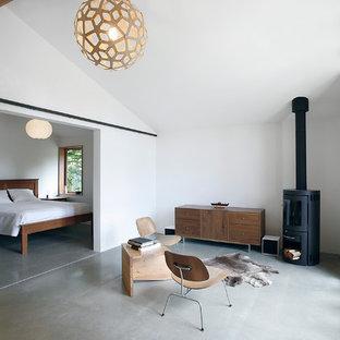 Kleines Retro Wohnzimmer mit Betonboden in Seattle