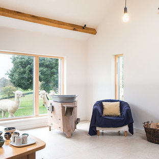 Inspiration for a rustic living room in Hampshire with white walls, a wood burning stove and no tv.