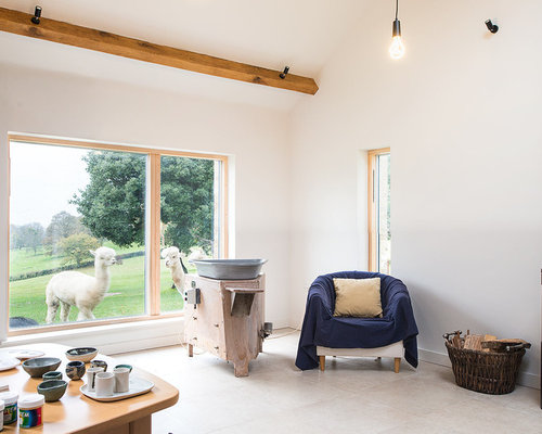 Inspiration For A Rustic Living Room In Hampshire With White Walls, A Wood  Burning Stove