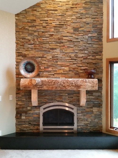 stacked stone fireplace surround and mantle