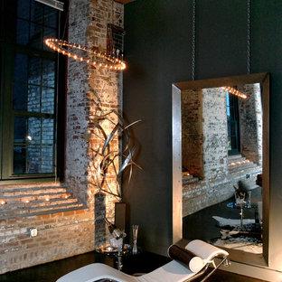 Idee per un soggiorno moderno di medie dimensioni e stile loft con sala formale, pareti grigie e pavimento in cemento