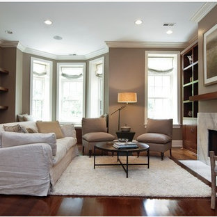 Inspiration for a mid-sized transitional formal dark wood floor living room remodel in Chicago with brown walls, a standard fireplace, a stone fireplace and no tv