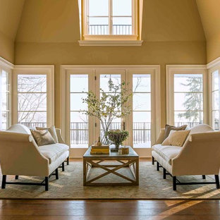 Mid-sized transitional open concept and formal medium tone wood floor living room photo in Chicago with beige walls