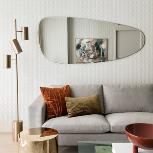 This is an example of a mid-sized midcentury living room in New York with light hardwood floors, beige floor and beige walls.