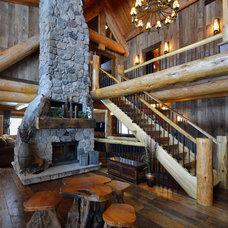 Rustic Living Room by Lake Country Builders