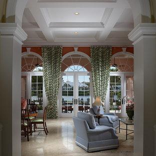 マイアミの中サイズのトラディショナルスタイルのおしゃれな独立型リビング (フォーマル、赤い壁、大理石の床、標準型暖炉、木材の暖炉まわり、テレビなし、ベージュの床) の写真
