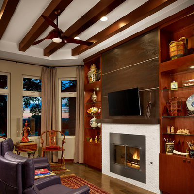 Inspiration for a zen dark wood floor living room remodel in Austin with beige walls, a standard fireplace and a wall-mounted tv