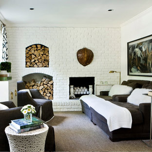 Example of a trendy enclosed living room design in Atlanta with white walls, a standard fireplace and a brick fireplace