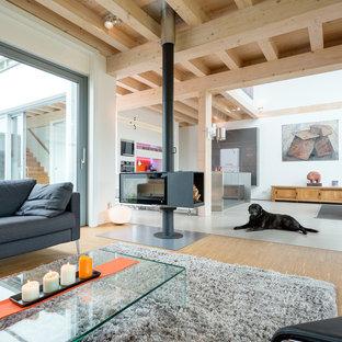 Salon avec un poêle à bois Cologne : Photos et idées déco de salons