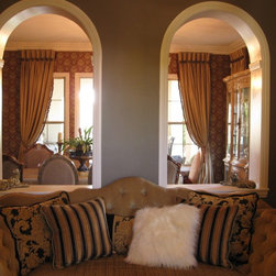 Stone Bridge Residence - Two arches in the parlor allow for a more spacious feeling as well as a view of the beautiful draperies in the dining room.