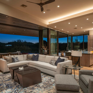 This is an example of a medium sized contemporary open plan living room in Phoenix with medium hardwood flooring and brown floors.