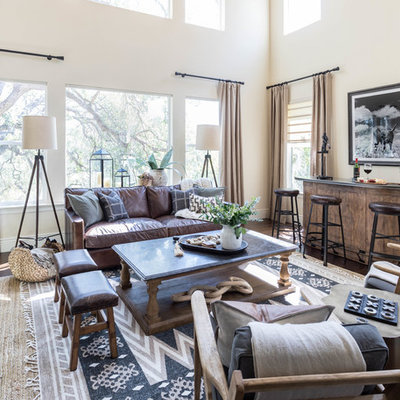 Living room - large rustic dark wood floor and brown floor living room idea in Sacramento with a bar, beige walls and no tv