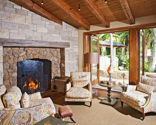 rock fireplace mantel. Example Of A Tuscan Living Room Design In Los Angeles With Beige Walls  Standard Rock Fireplace Mantel Houzz