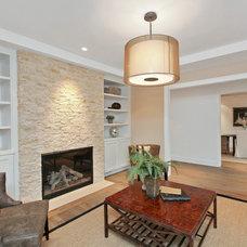 Farmhouse Living Room by Hughes Construction, Inc