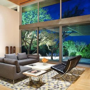 Living room - modern open concept living room idea in Austin