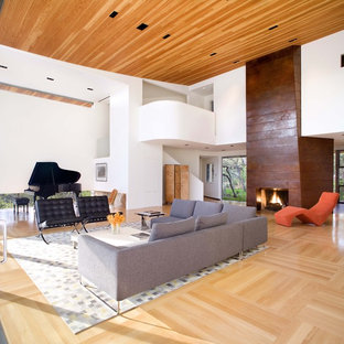 Example of a huge trendy living room design in Austin with a music area and white walls