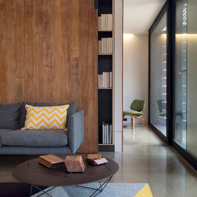 Living room library - contemporary open concept concrete floor living room library idea in Melbourne with white walls