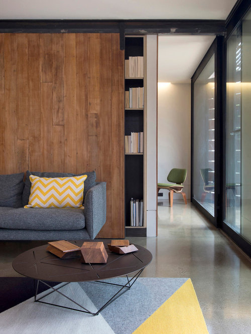 bookshelf in living room. Contemporary open concept concrete floor living room library idea in  Melbourne with white walls Living Room Bookshelf Houzz