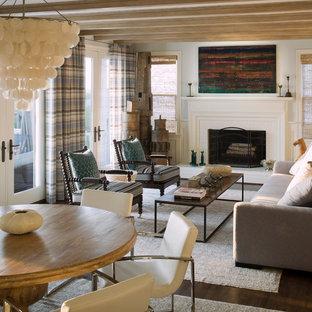 ボルチモアのビーチスタイルのおしゃれなLDK (グレーの壁、濃色無垢フローリング、標準型暖炉、木材の暖炉まわり、テレビなし) の写真