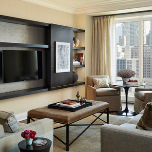Mid-sized transitional enclosed dark wood floor and brown floor living room photo in Chicago with no fireplace, a media wall and beige walls