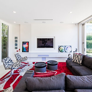 Design ideas for a contemporary enclosed living room in Sydney with white walls, a wall-mounted tv and beige floor.