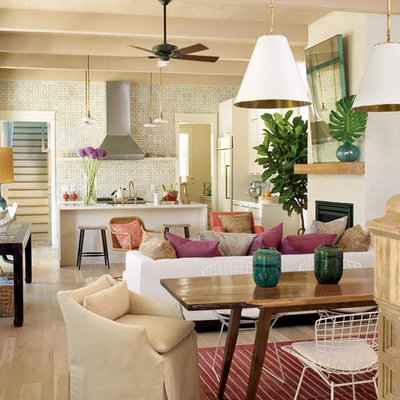 Inspiration for a tropical living room remodel in Charleston with white walls and a standard fireplace