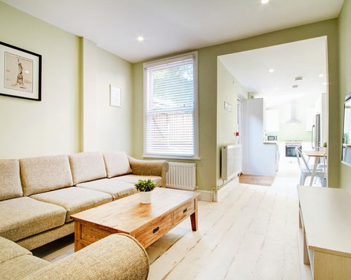 Example Of A Large Formal Open Concept Living Room Design In London With Green Walls