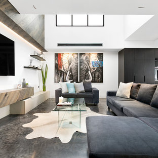 Inspiration for a contemporary open concept living room in Sydney with white walls, no fireplace, a wall-mounted tv and grey floor.